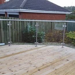 Decking with steel handrails & glass panels
