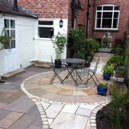 Back yard paved with circular feature